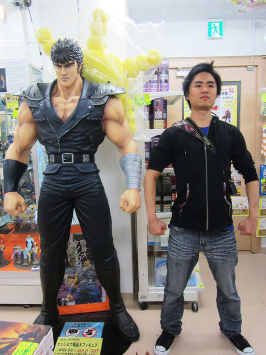 posing next to some game character